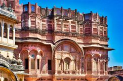 Intricate architecture in ancient Jaipur. Rajasthan India. Pink and gold adorn the filigree work on the facade of this home in India stock photography