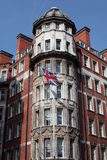 Intricate Architecture in Central London. Tall historical building in London with a Union Jack flag hanging from the wall to celebrate the 2012 Olympics Stock Photos