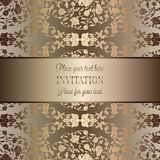 Intricate baroque luxury wedding invitation card. Rich gold decor on beige background with frame and place for text, lacy foliage with shiny gradient Stock Photo