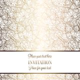 Intricate baroque luxury wedding invitation card. Rich gold decor on beige background with frame and place for text, lacy foliage with shiny gradient Stock Image