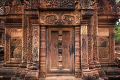 Intricate carved door of Angkor temple Stock Photos