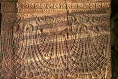 Intricate Carving. Detail of intricate stone pillar carving at cave temple in Badami, Karnataka, India, Asia royalty free stock photography