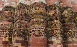 Intricate Carvings on Qutb Minar. Inscriptions on qutb minar, the tallest brick minaret in the world ( 72.5 metres (239 ft)) inspired by the Minaret of Jam in Royalty Free Stock Image