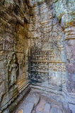 Intricate carvings on a temple wall in siem reap,cambodia Stock Photos