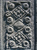 Intricate Celtic carving. Celtic carvings on an ancient monument at Iona Abbey stock images