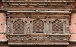 Intricate design on ancient window of Hanuman Dhoka Durbar Royalty Free Stock Image