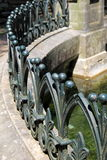 Intricate detail of curving barrier near water's edge Stock Photo