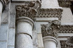 Intricate Detail In Carvings On Old Stone Columns Of Building Stock Image