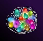 Intricate garlands. Beautiful colorful holidays decorations. Christmas lights on dark background. Royalty Free Stock Photos