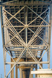 Intricate Geometric Patterns of Steel and Iron Works of the Underside of a Coastal Bowstring Bridge Stock Photo