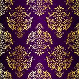 Intricate Gold-on-Purple seamless sari pattern Stock Photos