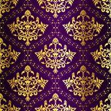 Intricate Gold-on-Purple seamless sari pattern Stock Images