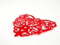 Intricate heart pattern. Red intricate heart pattern on white background Stock Photo