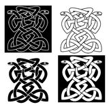 Intricate intertwined snakes emblem Stock Images