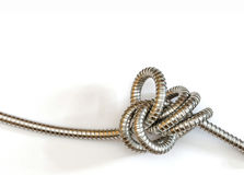 Intricate metal hose knot Royalty Free Stock Photo