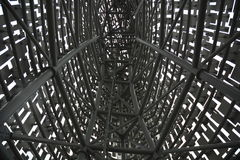 Intricate Metal Structure – Inside a metal structure looking at the steelwork Royalty Free Stock Image