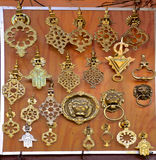 Metal Door Knockers at a Moroccan Souk. Intricate ornate handmade metal door knockers at a moroccan souk in Marrakech Royalty Free Stock Photos