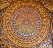 Intricate patterned ceiling in Madrasah in Uzbekistan. Intricate patterned ceiling in Tilla Kari Madrasah in Uzbekistan stock photos