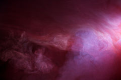 Intricate Red and Blue Smoke. Black ground with deep red smoke with blue hazy accents stock photos