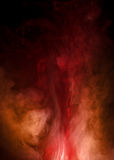 Intricate Red and orange Smoke. Black ground with deep red smoke with orange accents Royalty Free Stock Photo