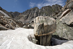 Intricate rock among snow, Sayan mountains.Siberia Royalty Free Stock Photos