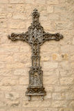 Intricate Rusty Iron Cross. Intricate old cross depicting Jesus among Angels Royalty Free Stock Photos