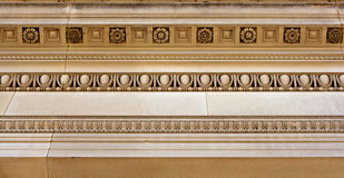 Intricate sandstone cornice work. Intricate cornice mouldings on sandstone building royalty free stock photography