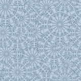 Intricate seamless floral pattern. Repeating background with overlapping blue flowers. Vector Stock Photos