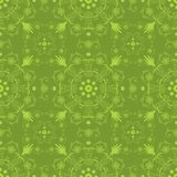 Intricate seamless hand drawn floral background. Vintage vector seamless hand drawn background with intricate floral lace motifs in green. Unique moroccan or Royalty Free Stock Photo