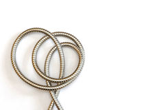 Intricate shape formed by a flexible metal hose Stock Photography