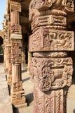 Qutb complex stone carvings, Delhi. Intricate stone carvings on the cloister columns at Quwwat ul-Islam Mosque. Qutb complex, Delhi Stock Photos