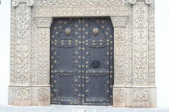 Intricate Stonework frames large metal door in Antigua Guatemala Stock Images