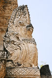 Intricate Thai Architecture. A sculpture of the great snake king, Naga, on the side of an ancient Siamese temple in Sukothai Historical Park in northern Thailand Stock Photography