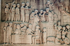Intricate Thai carving mural -  Thai King activity help people Royalty Free Stock Image