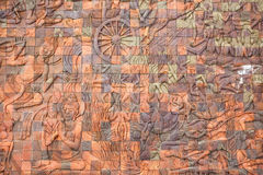 Intricate Thai carving mural Royalty Free Stock Images