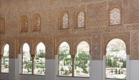 Intricate window detail inside the Alhambra palace Stock Photo