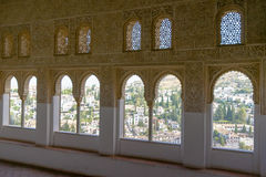 Intricate window details. Inside the Alhambra palace in Granada Stock Photo