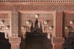 Intricately carved red stone gateway at the Red Fo Stock Images