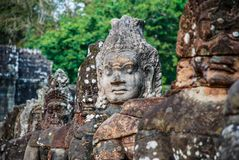 Intricately sculpted heads in the temples of Angkor Wat stock photography