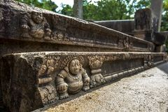 Intrigate stone carvings on a wall of the Ratnaprasada at the ancient site of Anuradhapura in Sri Lanka. Stock Image