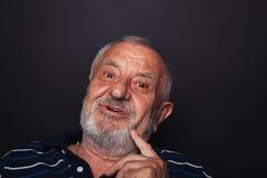 Intrigierter alter Mann 2 Stockfotografie