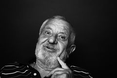 Intrigued old man Stock Images