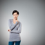 Intriguing look. Isolated on grey background Stock Photo