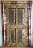 Intriguing pattern on a wooden door. Door with a special pattern on it Royalty Free Stock Image