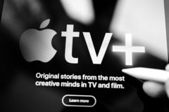 Introducing Apple TV Plus streaming service. Paris, France - Mar 27, 2019: POV man holding Apple Pencil over the new iPad Pro Introducing Apple TV Plus streaming stock images
