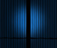 Introducing on a blue curtain stage Stock Images