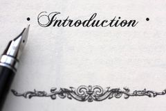 Introduction. A word 'Introduction' on white paper with a pen aside royalty free stock image