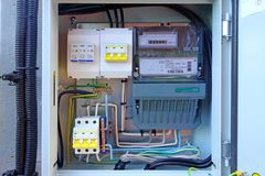 Introductory electrical box with three-phase electricity meter. And circuit breakers Stock Photos