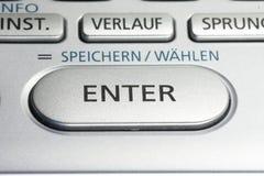 INTRODUISEZ la clé sur un clavier numérique Photo stock