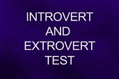 Introvert and extrovert test written on ultra violet background.  royalty free stock photos
